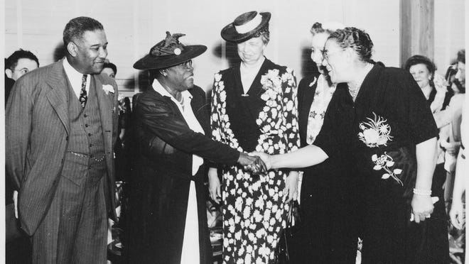 Eleanor Roosevelt, Mary McLeod Bethune and others at the opening of Midway Hall, one of two residence halls built by the Public Buildings Administration of the Federal Works Agency.