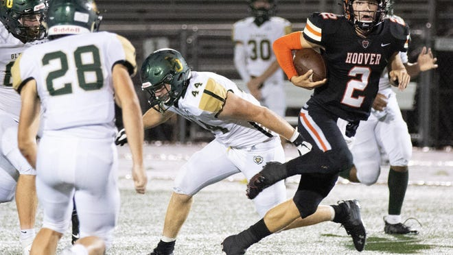 Hoover\xe2\x80\x99s quarterback (2) Connor Ashby scrambles through the GlenOak defense Friday, Aug. 28, 2020.