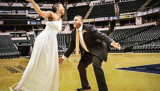 Before their wedding ceremony, Tamika Catchings played around with husband Parnell Smith at Bankers Life Fieldhouse for photos.