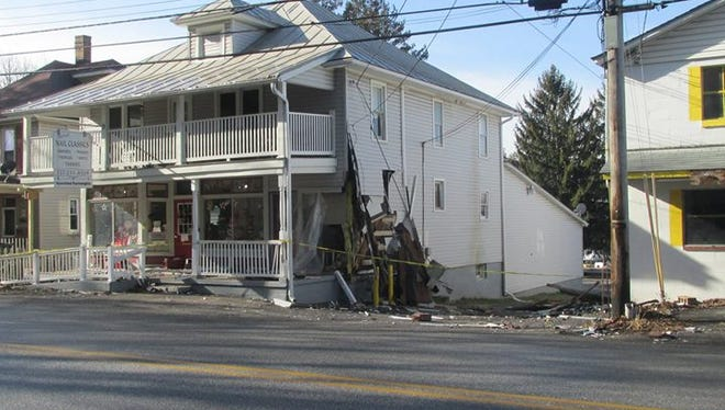 This business and apartment building were damaged over the weekend when a vehicle crashed into it. The driver faces charges in connection with the crash.
