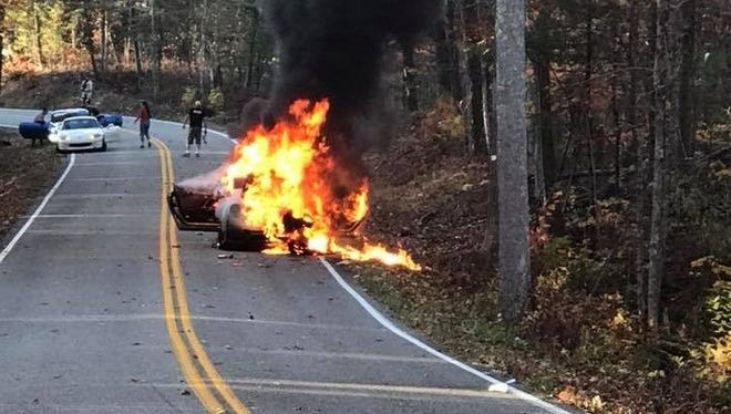 """A 2017 Nissan GT-R (possibly Nismo) burns on a stretch of U.S. Highway 129 known as """"The Dragon"""" on Sunday, Nov. 5."""