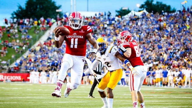 UL quarterback Anthony Jennings (11) jumps into the end zone en route to a 3-yard touchdown run during a win over McNeese State earlier this season.