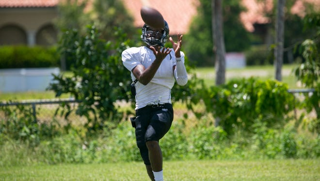 Darnell Gouin makes a catch at practice on Wednesday at South Fort Myers High School.