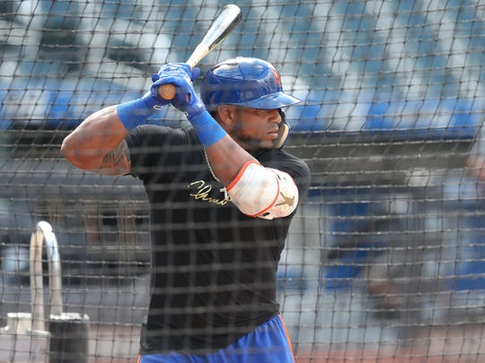 Jun 5, 2018; New York City, NY, USA; New York Mets injured left fielder Yoenis Cespedes (52) takes batting practice before a game against the Baltimore Orioles at Citi Field.