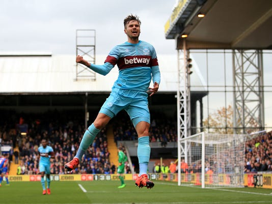 West Ham United's Carl Jenkinson celebrates scoring his side's first goal of the game during their English Premier League soccer match against Crystal Palace at Selhurst Park, London, Saturday, Oct. 17, 2015. (John Walton/PA via AP)     UNITED KINGDOM OUT       -    NO SALES      -     NO ARCHIVES