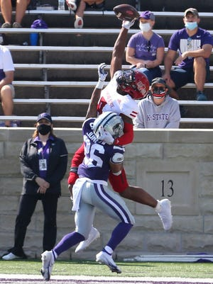 Kansas State defensive back Will Jones (26) tries to break up a one-handed catch by Arkansas State wide receiver Jonathan Adams (9) during the Wildcats' season opener Sept. 12 at Bill Snyder Family Stadium.