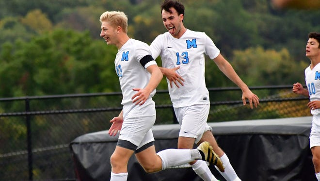 George Oliarnyk (23) and Trent Murphy (13) celebrate during a game against Dwight Morrow on Oct. 23, 2017.