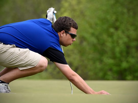 Sartell's Austin Pietrowski lines up a putt during the St. Cloud Apollo Invitational Golf Tournament Monday, May 15, at The Territory Golf Club.