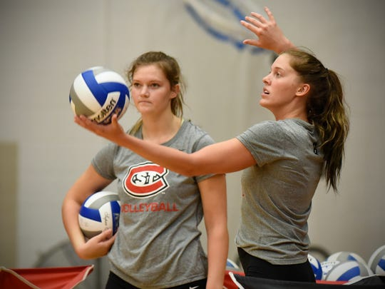 Abby Templin and Erin Navratil practice serves during