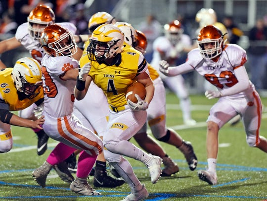 Red Lion's Tyler Ness carries the ball against Central