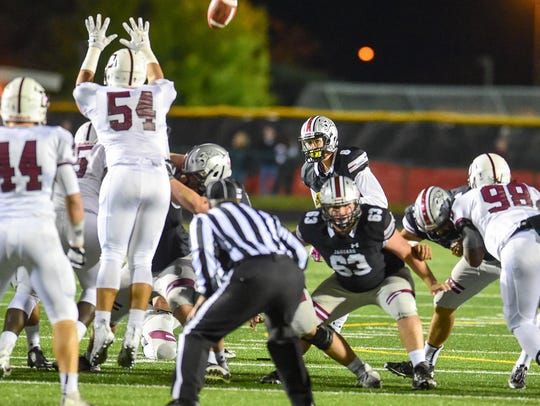 Ankeny Centennial kicker Jake Pinegar (8) kicks a 50-yard