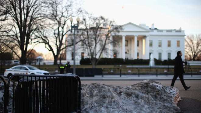 Melting snow and barricades sit in front of the White House on March 12, 2015, in Washington, D.C.