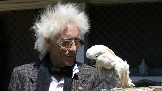 Bill Levin, a cannabis advocate and leader of the First Church of Cannabis, at his Indianapolis home May 19, 2015, with his 19-year-old cockatoo, Charlie.