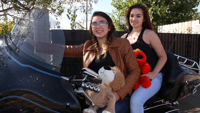 Cheyenne, left, and Dee Padron help out annually with the Shop With A Cop program locally. They encourage members of the community to support the charitable cause that brings Christmas joy to children in Deming and Luna County.