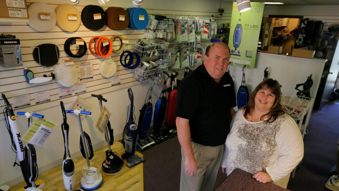 Mark and Cindy Hoffman of Wall, owners of Oreck Clean Home Center, stand in their Avon store. They also own a store in Brick.