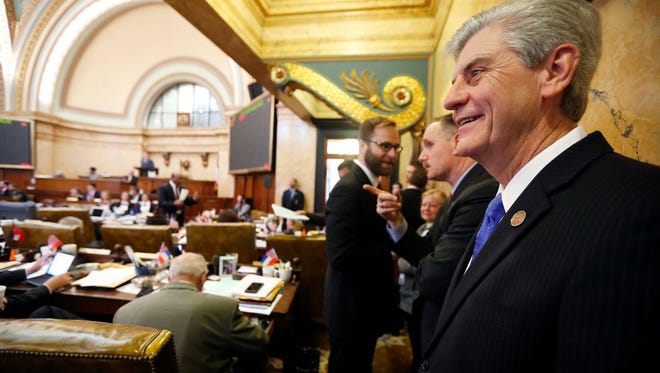 Republican Gov. Phil Bryant, smiles as he listens to the House discussion of an incentive bill for a tire plant in western Hinds County and a shipyard in Gulfport, Thursday, Feb. 4, 2016, at the Capitol in Jackson, Miss. Bryant set Thursday's special session for the two economic development projects that could create 3,500 jobs.