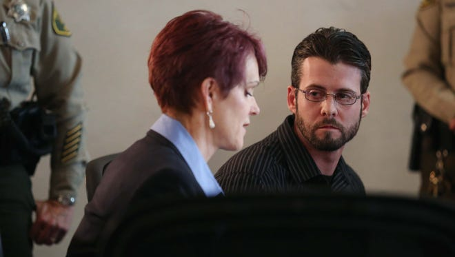 Patrick Kirwan, 31, of Des Moines, talks to his attorney Valorie Wilson after being found guilty of murder on Thursday, April 14, 2016, at the Polk County Courthouse.