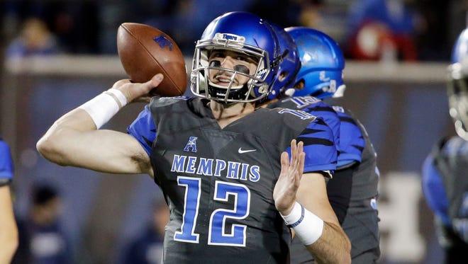 Memphis quarterback Paxton Lynch warms up before a game against Navy on Nov. 7, 2015, in Memphis, Tenn.
