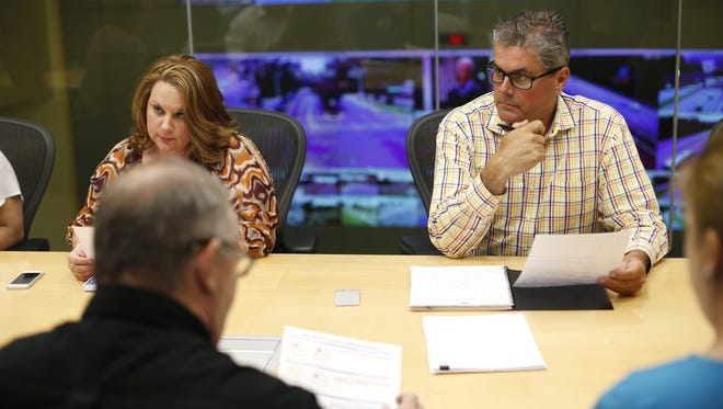 Interim CDA Director Dee Crumpler takes part in a data meeting on Thursday, evaluating average call times, dispatch times and total processing times.