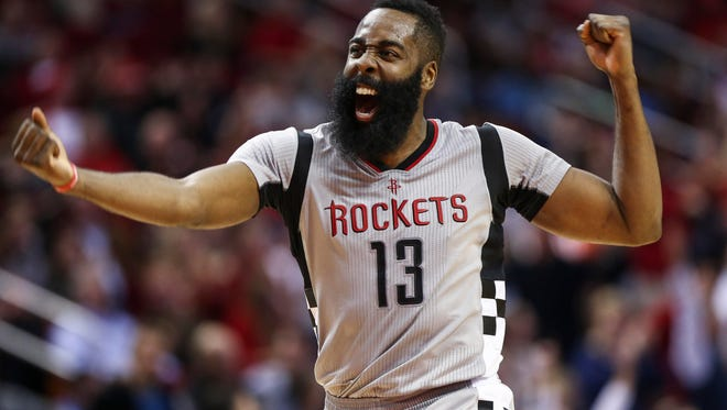 Houston Rockets guard James Harden (13) celebrates after getting an assist to give Harden a triple-double during the fourth quarter against the Los Angeles Clippers at Toyota Center.
