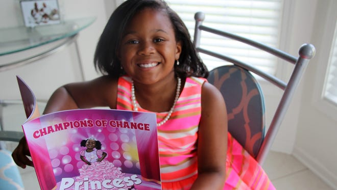 Jordan West, 7, of Greece wrote a book Princess for a Day about her experiences organizing magical events for girls in foster care.