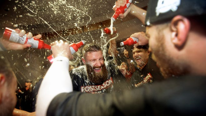 Arizona Diamondbacks Archie Bradley (center) has a champagne celebration in the clubhouse after defeating the Colorado Rockies to win the National League Wild Card game on Wednesday, Oct. 4, 2017 at Chase Field in Phoenix, Ariz.