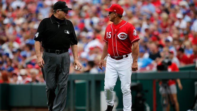 Cincinnati Reds interim manager Jim Riggleman (35) asks for a review of the Chicago Cubs catcher Willson Contreras (40) home run, looking for fan interference, in the second inning of the MLB National League game between the Cincinnati Reds and the Chicago Cubs at Great American Ball Park in downtown Cincinnati on Saturday, June 23, 2018. The Reds led 8-1 after three innings.