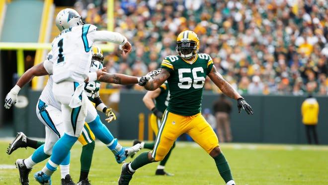 Packers linebacker Julius Peppers pressures Panthers quarterback Cam Newton.