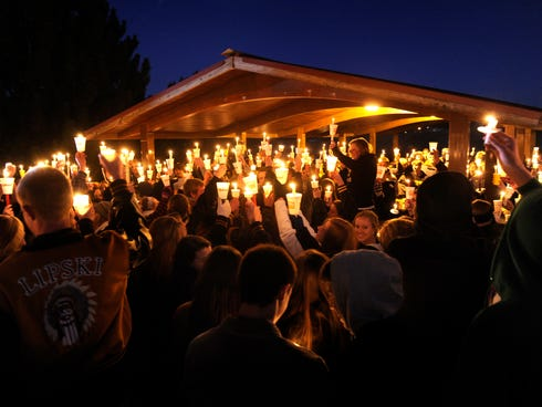 Hundreds of Arapahoe High School students gather for a candlelight vigil Saturday night, Dec. 14, 2013,  to pray for Claire Davis who was shot inside the school Friday, Dec. 13. The vigil was held at Arapaho Park in Centennial, not far from the schoo