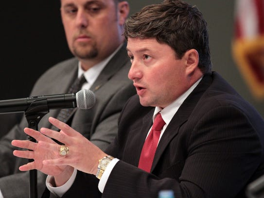 Erick Knezek, right, speaks at a forum as a school
