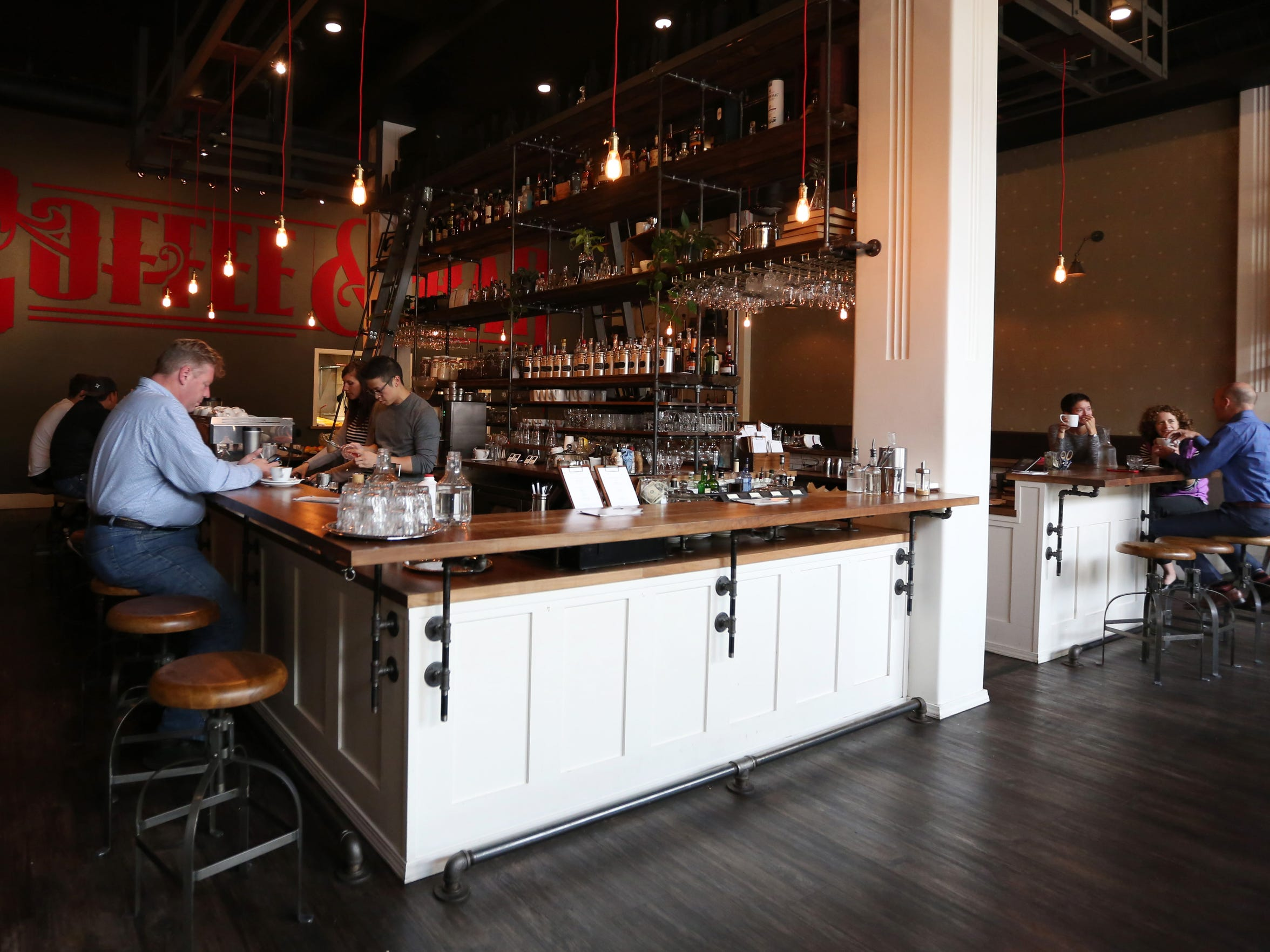 Customers sit at the bar at Archive Coffee & Bar in downtown Salem. During the day, Archive roasts and serves specialty coffee. At night, spirits, cocktails, wine and beer are served.