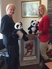 Office staff Casey and Courtney collect toys at Holmdel Periodontics & Implant Dentistry.