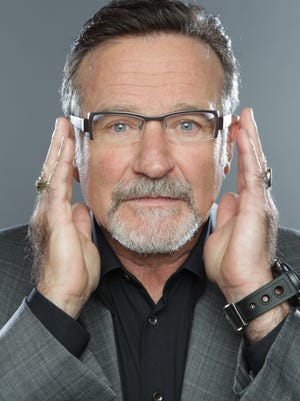 Actor and comedian Robin Williams hams it up for the camera in 2010.
