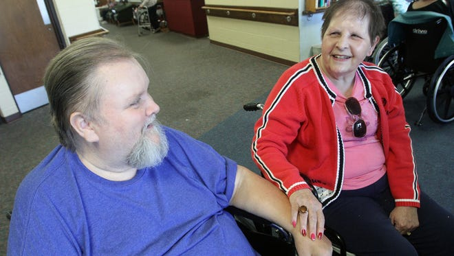 Davy Jones and his wife of one week Penny Jones share their wedding day memories at the Marion Manor Nursing Home on Friday, Aug. 15, 2014. James Miller/The Marion Star