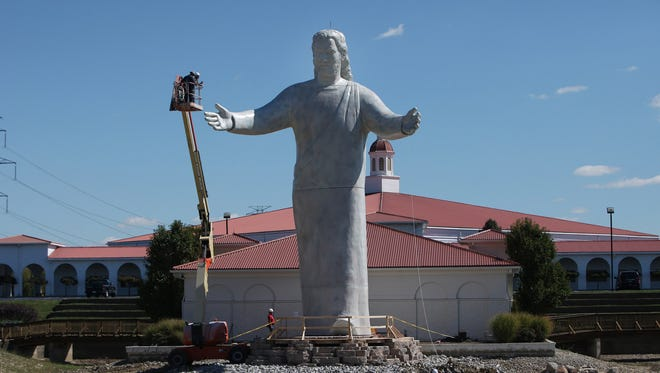 A new Jesus statue was constructed at Solid Rock Church after the previous one caught fire after being struck by lightning.