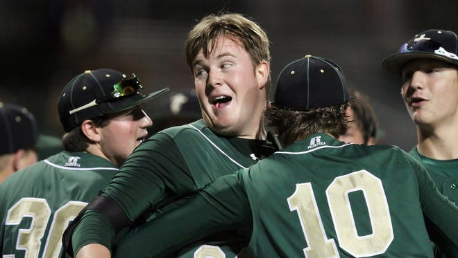 Trinity Catholic's Dash Winningham, center, celebrates with teammates after hiting a home run against Bishop Verot during the Class 4A state semifinal on Wednesday at jetBlue Park in Fort Myers. Winningham has committed to playing at FGCU next year.