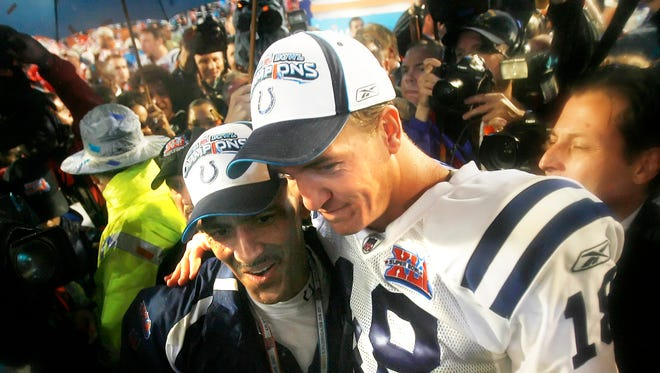 Indianapolis Colts coach Tony Dungy and QB Peyton Manning embrace after defeating the Chicago Bears in Super Bowl XLI on February 4, 2007 at Dolphins Stadium in Miami, Fla.