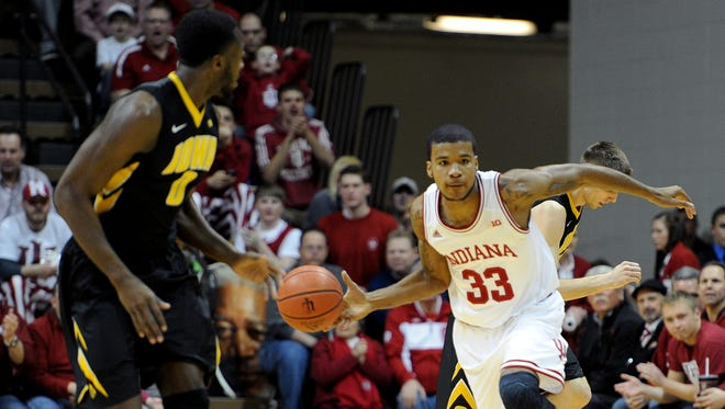 Indiana forward Jeremy Hollowell pushes the ball up court against Iowa inside Assembly Hall, Thursday, February 27, 2014, in Bloomington.
