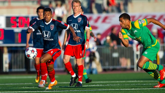 Indy Eleven's Kl?eberson (8) races after the ball during the first half of action. Indy Eleven faced Tampa Bay Rowdies Saturday, April 19, 2014, in the team's second match of their inaugural season.