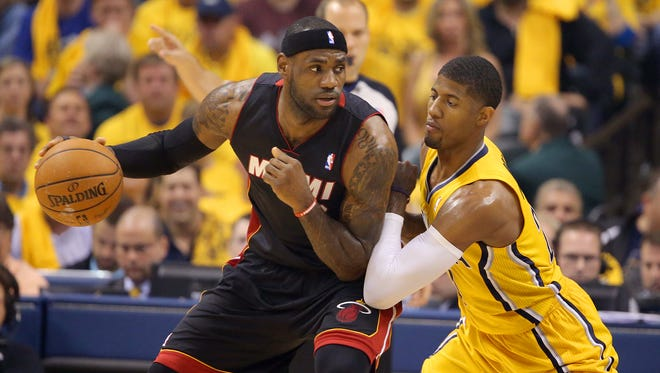 Pacers forward Paul George pressures Miami Heats forward LeBron James on the ball during the first half of action. Indiana Pacers play the Miami Heat in Game 2 of the NBA Eastern Conference Finals Tuesday, May 20, 2014, evening at Bankers Life Fieldhouse.