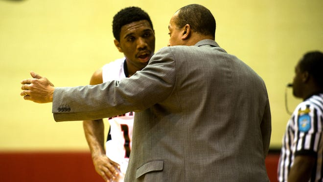 FILE - North Central's Eron Gordon receives instructions from Head Coach Doug Mitchell during a break in action in the second quarter. North Central High School defeated Park Tudor in boys basketball Feb. 1, 2014.