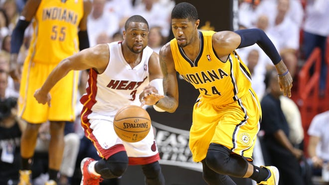 Paul George (24) dribbles on a break away from Dwyane Wade (3) during Game 6 of the Eastern Conference Finals between the Indiana Pacers and the Miami Heat inside American Airlines Arena, Friday, May 30, 2014, in Miami, Fla.