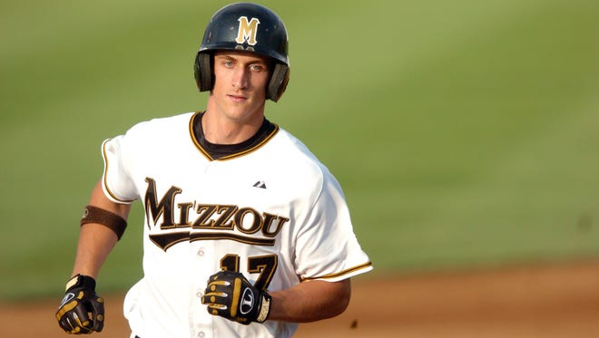 FILE - In this June 3, 2007, file photo, Missouri's Aaron Senne rounds second base after hitting a solo home run in the second inning of an NCAA Regional baseball game against Louisville in Columbia , Mo. Senne and former minor-league players in each of the 30 big-league organizations are suing Major League Baseball, alleging violations of federal wage and overtime laws in a case some legal observers suggest has significant merit.