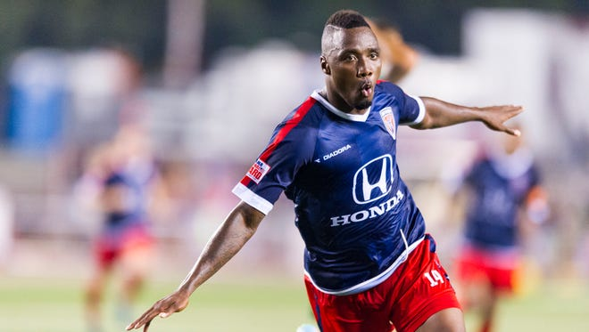 Indy Elevenâ??s Jermaine Johnson (14) celebrates the game-tying goal during the extra time after the second half of action. Indy Eleven hosted New York Cosmos in NASL soccer action at Michael A. Carroll Track & Soccer Stadium in Indianapolis, Saturday, August 30, 2014. The game ended in a 2-2 tie.