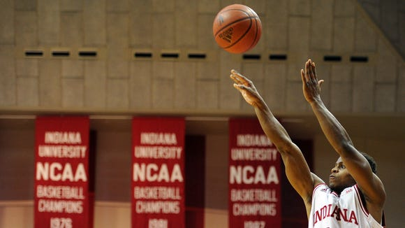 Indiana guard Yogi Ferrell shoots a three-point basket against Wisconsin inside Assembly Hall, Tuesday, January 14, 2014, in Bloomington.