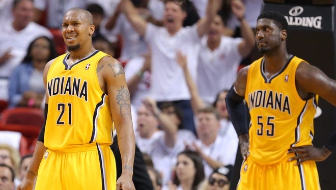 David West (21) and Roy Hibbert (55) react to a play called during Game 6 of the Eastern Conference Finals between the Indiana Pacers and the Miami Heat inside American Airlines Arena, Friday, May 30, 2014, in Miami, Fla.