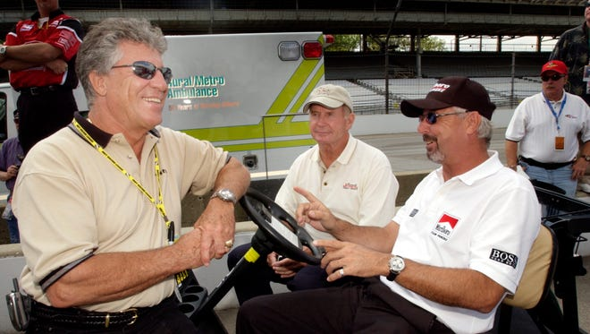 FILE -  Indianapolis 500 legends Mario Andretti, left, Parnelli Jones, and Rick Mears, right, talk as they wait for the start of the pit stop competition in 2003.