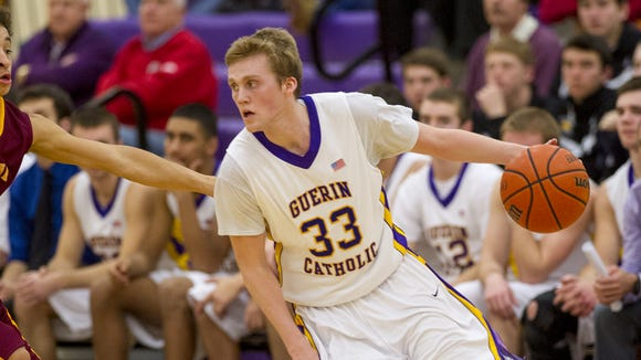 Guerin Catholic High School senior Whit Rapp (33) drives the ball across the court during the second half of boys varsity basketball action at Guerin Catholic High School Wednesday, Feb. 19, 2014. Guerin Catholic defeated Scecina 73-61.