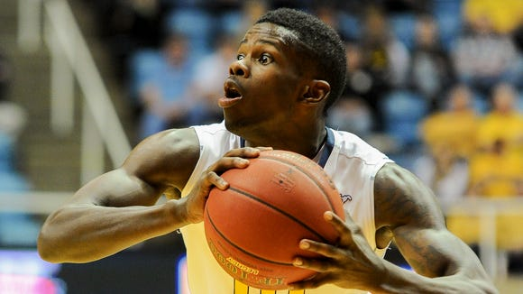 West Virginia's Eron Harris (10) looks to pass during the second half against Georgia Southern, Nov. 21, 2013, in Morgantown, W.Va.