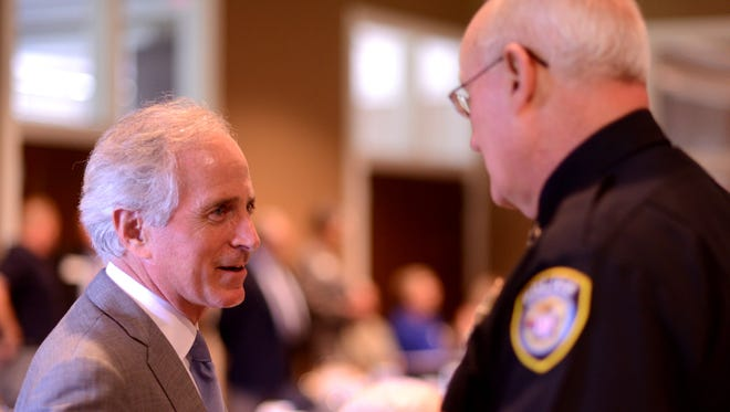 U.S. Sen. Bob Corker (left) speaks with Jackson Police Chief Gill Kendrick (right) before the Jackson Rotary Club and Jackson Young Professionals meeting Wednesday at the Jackson Country Club. Corker also spoke with The Jackson Sun editorial board, saying he hasn't ruled out a run for president in 2016.